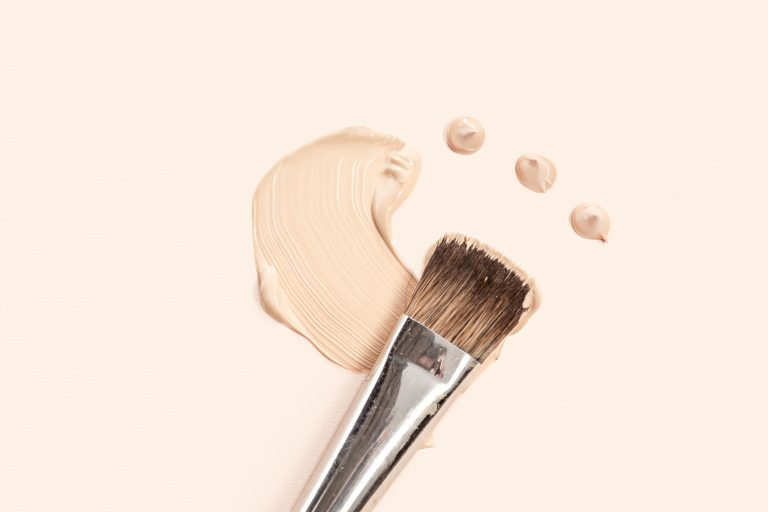 beige foundation with a brush 1
