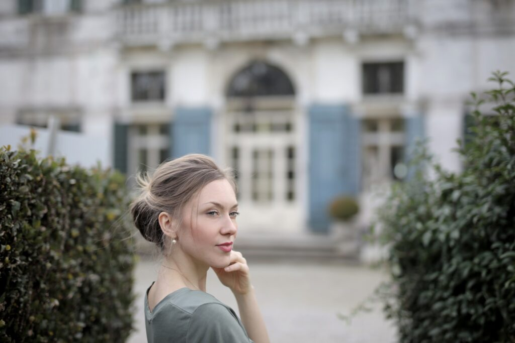 pensive woman on background of old palace among plants 3831034 1